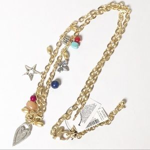 Chico's long charm necklace in gold NWT